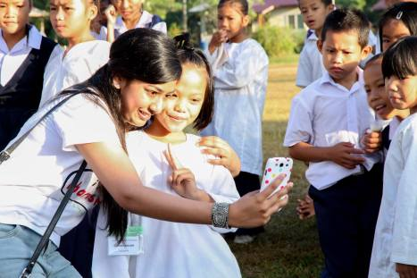 Taking selfies with kampung kids
